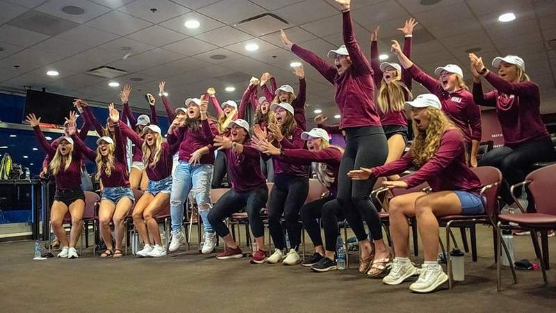 Members of the Saluki softball team react to news of their NCAA Regional assignment.