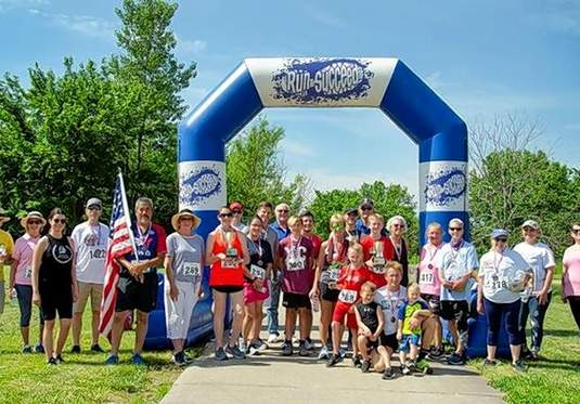 Shown are medal winners and volunteers from the Benton Rotary Club's first 5K Walk/Run for a Cause event.