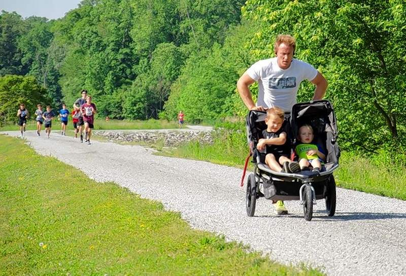 Jason Corn, the current president of the Benton Rotary Club, finished fourth overall despite pushing a stroller containing his two young sons for the entire race.