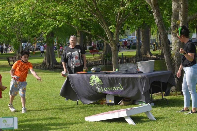 An East Side student plays a bag toss game.