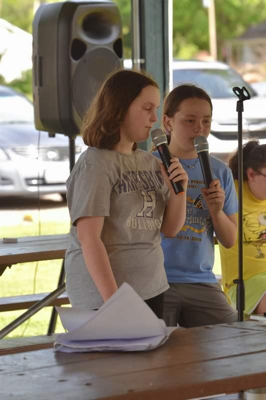 Two East Side students sing karaoke.