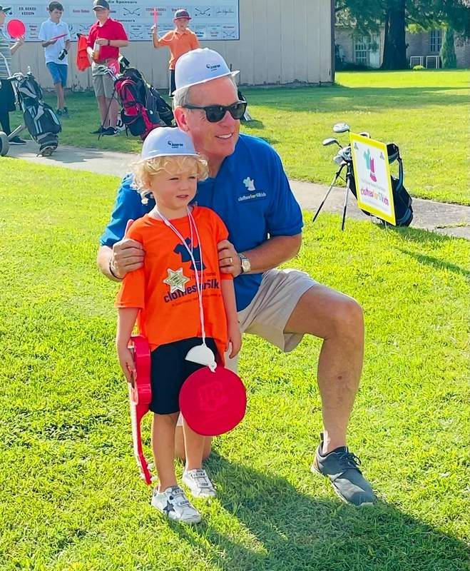 PHOTO COURTESY OF FOWLER BONAN FOUNDATIONState Sen. Dale Fowler poses for a photo with a junior golfer at his junior golf fundraiser Thursday.