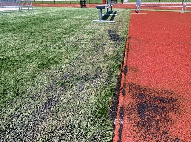 A section of the football field at Du Quoin High School, showing where the rubber separated from the concrete.