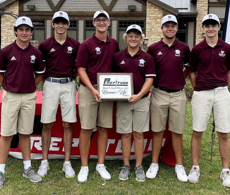 The Benton boys' golf team poses with their second place plaque after finishing runner up at the IHSA Showcase in Seneca.