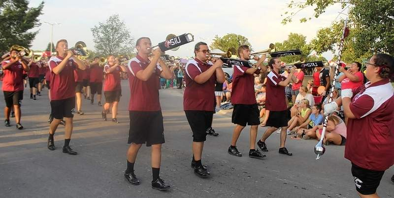 Dressed appropriately for the hot weather, the Marching Saluki Band gives the parade crowd some music.