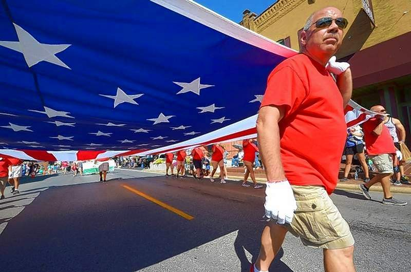 Twenty members of the Murphysboro Elks Club marched while carrying their giant 20 by 40 foot American flag march in 15th Annual Veterans Parade in Marion.