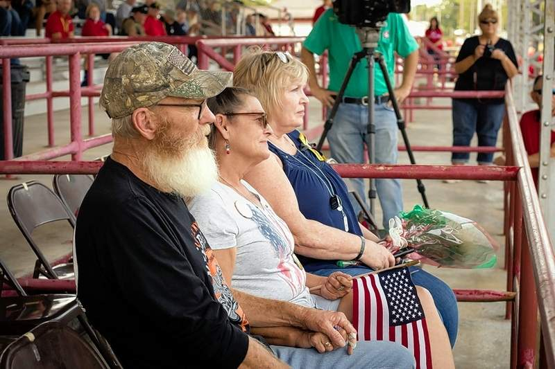 Parents of two local fallen soldiers, Sgt. Brian M. Romines of Anna and L. Cppl Johnathon Kyle Price of Woodlawn, were recognized in memory of their sons at the Williamson County Fairgrounds.