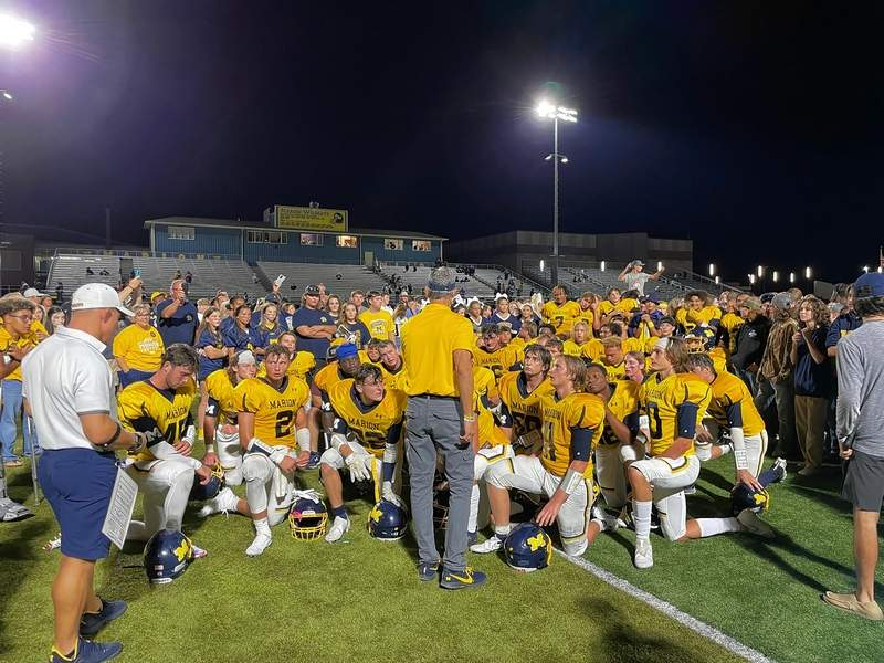 Marion head coach Kerry Martin gives a postgame talk to the Wildcats following Friday's win over Highland.