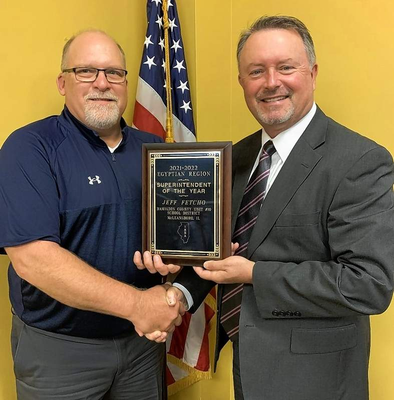 Jeff Fetcho, right, accepts the Egyptian division Superintendent of the Year award from Pinckneyville High School Superintendent Keith Hagene.