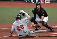 Miners catcher Andy Cosgrove waits to apply a tag to this Joliet baserunner during the final season in a game against the Joliet Slammers.